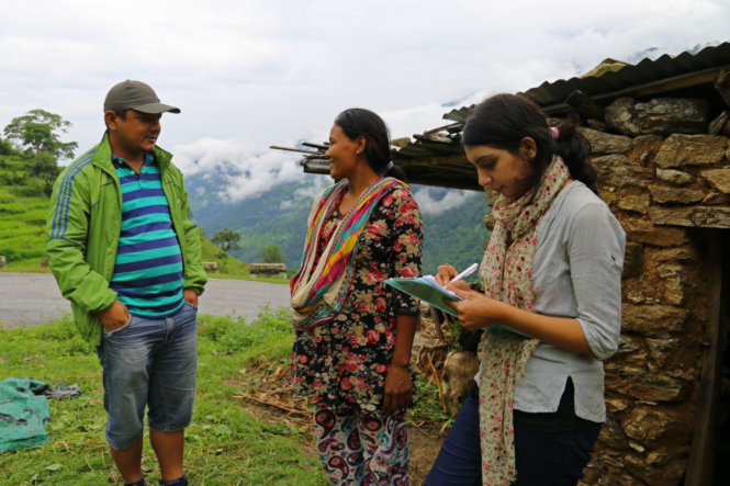 Image of two enumerators standing with a woman in Nepal as the survey is carried out.