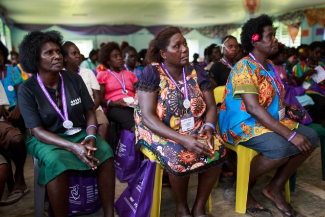 This is an image showing women sitting together in a hall in Bougainville. They are women's human rights defenders and they are listening to a speech that's underway.